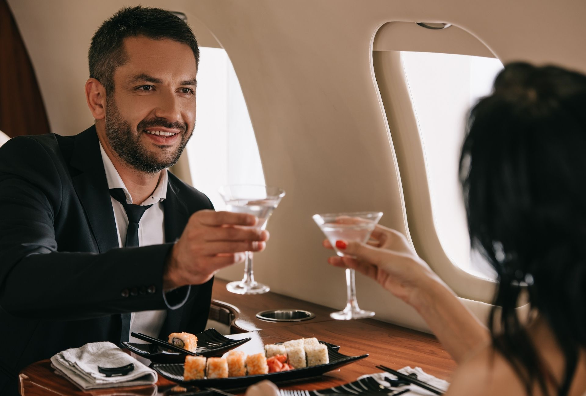 Private Jet Man and Women with Champaign